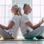 Senior couple doing yoga together