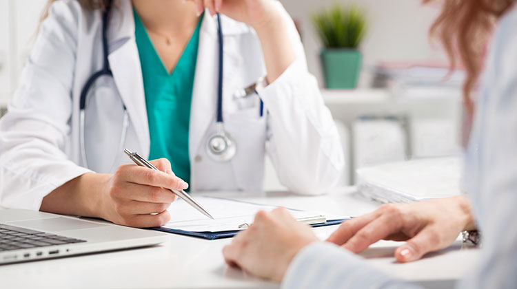 Doctor going over information with patient