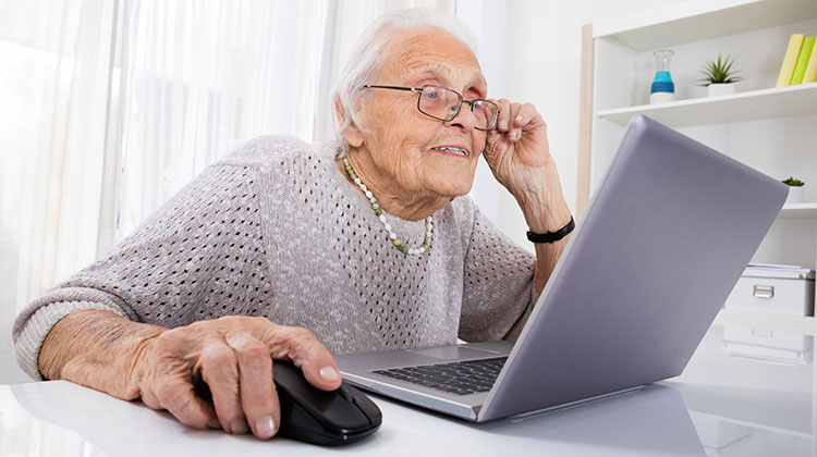 Senior woman using a laptop at home